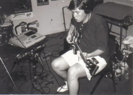 Early '90's picture of John recording demos on the Tascam 424 PortaStudio with his Eko Bass.